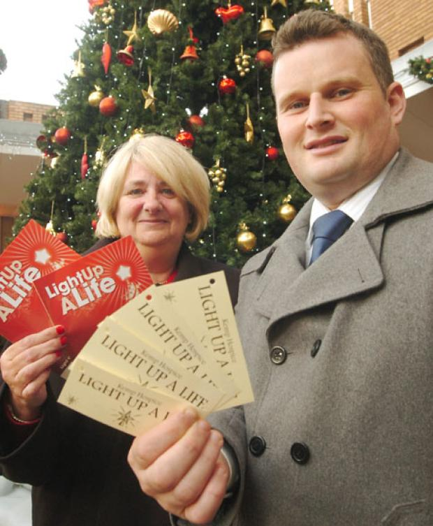 Tree of light: Swan Centre manager Ros Darby and Kemp Hospice fundraising manager Richard Brown launch the campaign.