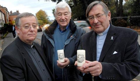 Light of hope: From left, Father Douglas Lamb, Peter Picken and Canon Paul Brothwell prepare for this year's RoadPeace service.