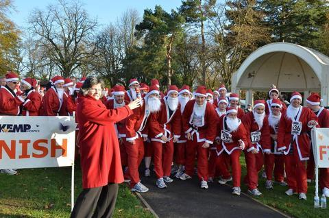 On the run: Fundraisers spread some festive spirit in Kemp Hospice's Santa Fun Run.