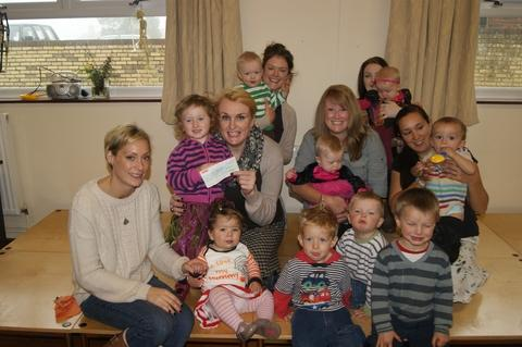 It's a toddle: Mums and toddlers from Clows Top who helped raise £800 with fun and games.