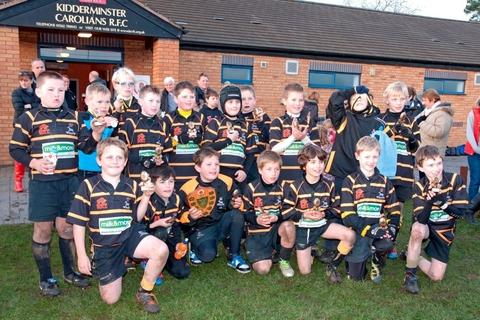 Kidderminster Carolians under-10s celebrate winning the Plate competition.