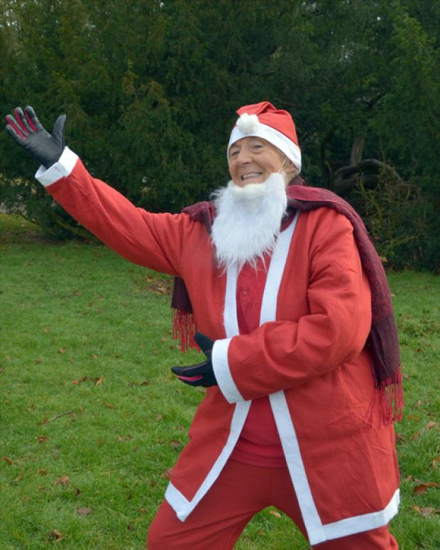 Fun runner: Gwen Ferriday, 83, as Santa. Photo: Colin Hill.