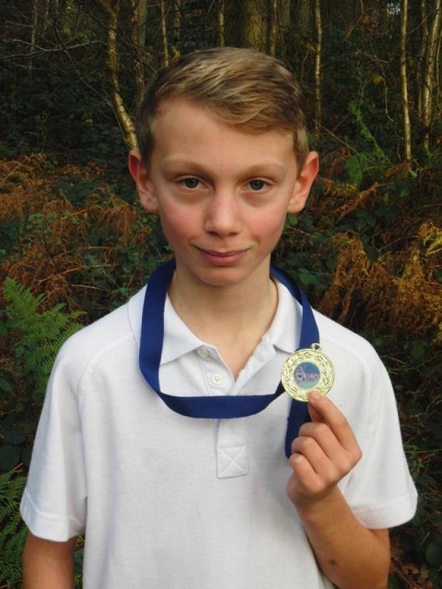 Going the distance: Bewdley School's Jak Patrick shows off the medal he won at the district cross country championships.