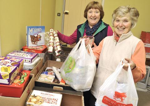 EMERGENCY FOOD: Foodbank treasurer Denise Carson, left and Maureen Lewis fill up the Baxter Church-based stockroom. Picture: Phil Loach. 521227L.