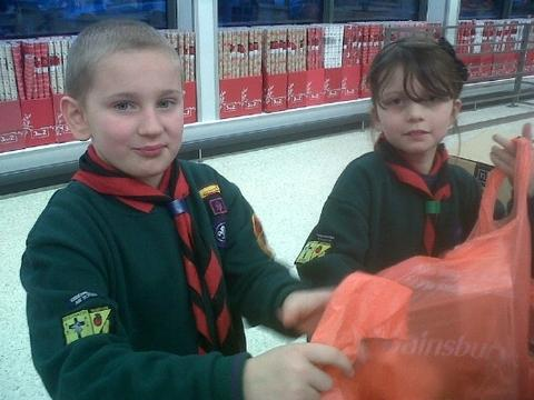 Bag packing: Alex Hudson, 8, left and Eliza Curzon, 10, of KD21 Cub pack help Sainsbury's shoppers.