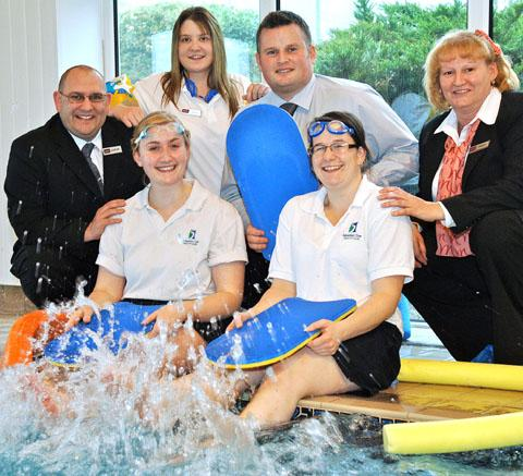 Making a splash: Kemp Hospice's fundraising manager Richard Brown, centre, with Sebastian Coe Health Centre staff.