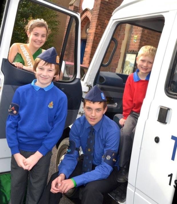 Upgraded transport: Carnival queen Hannah Cornish and 1st Kidderminster Boys' Brigade members, from left, Charlie Tindell, Oliver Reah and James Cook.