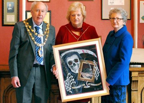 From the heart: Mayor John Aston, Mayoress Madeline Craddock and Kay Wood, with the painting.