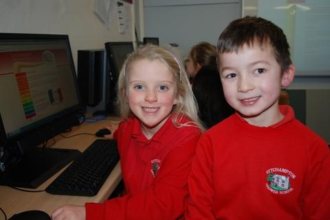 Logging on: Sytchampton Endowed First School pupils Rhianna Dunn and William Johnston-Hubbold, both aged seven.