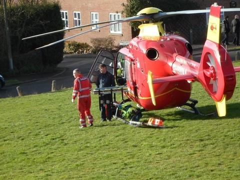Incident: The air ambulance lands at Sebright Green, Wolverley, to take a man to hospital. PHOTO: Lynda Hankins.