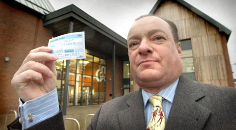 'Belittling': Gary Talbot with his visitor's pass used to attend Stourport Town Council meetings. Picture: PHIL LOACH. 051321L.