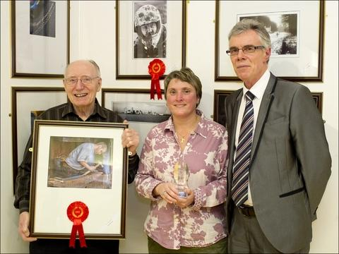 In the frame: Duncan McCormack and Laurie Abraham with their winning entries and Shuttle editor Clive Joyce (right).