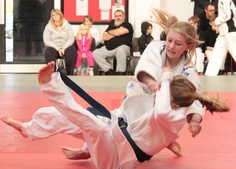 Darcie Hancocks floors an opponent at the Midlands Championships.