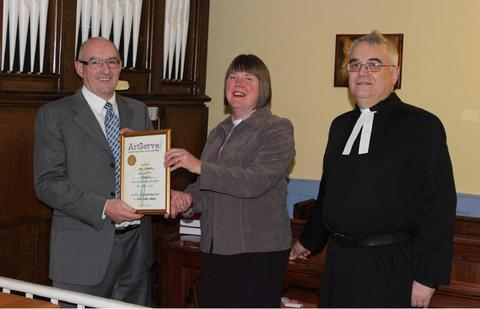 Fifty years: Neil Sollom, left, receives his long-service award from the Rev Linda Catlow, watched by the Rev Mark Wakelin.
