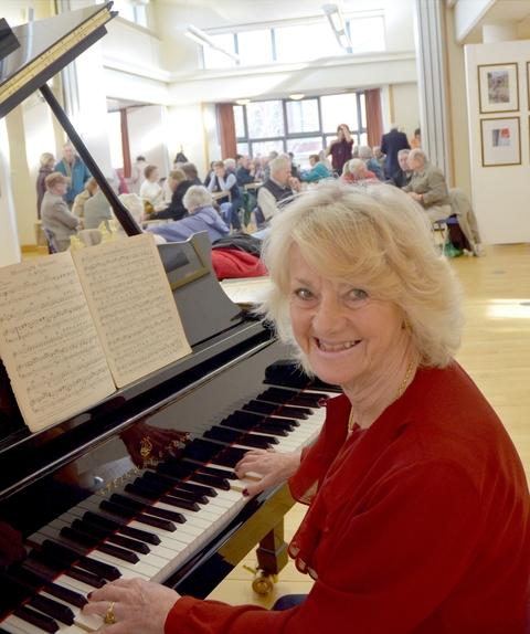 Encore!: Margaret Beresford plays the Steinway grand piano for the last time at Kidderminster Library's top-floor gallery. Picture: COLIN HILL.