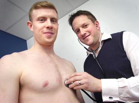 Check up: Midfielder Jack Byrne is assessed Dr Adam Cole from Aylmer Lodge surgery. Picture: PHIL LOACH