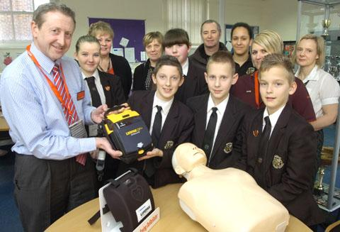 Life saving: Manager of Sainsburys Kidderminster Kevin Healey hand the defibrillator over to Wolverley Secondary School staff and pupils. Photo: Phil Loach. 081309L.