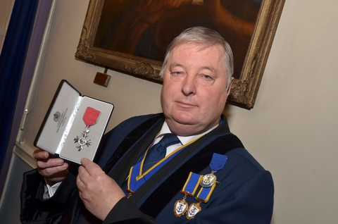 'Honoured': Paul Gittins with his MBE award. Picture: COLIN HILL.