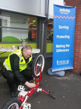 Combating theft: Local policing officer PC Andy Forbes marks a bicycle at Asda.
