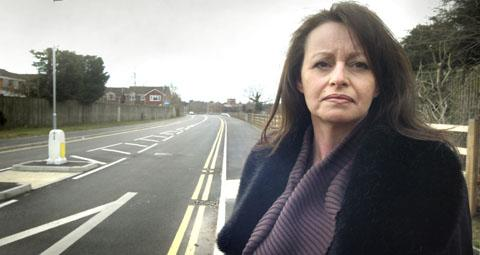 Risk to pedestrians: Esther McGilvray in the newly-extended road with no street lighting.
