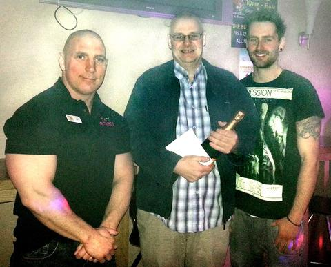 Loser is a winner: From left, 24/7 gym manager Rob Preston,                  competition winner Ian Calder and  personal trainer Mitch Gibbons.