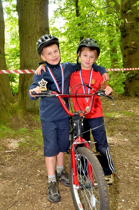 Pedal power: Cyclocross winners Jacob Rudd, left and Cameron Hamilton show off their trophies.