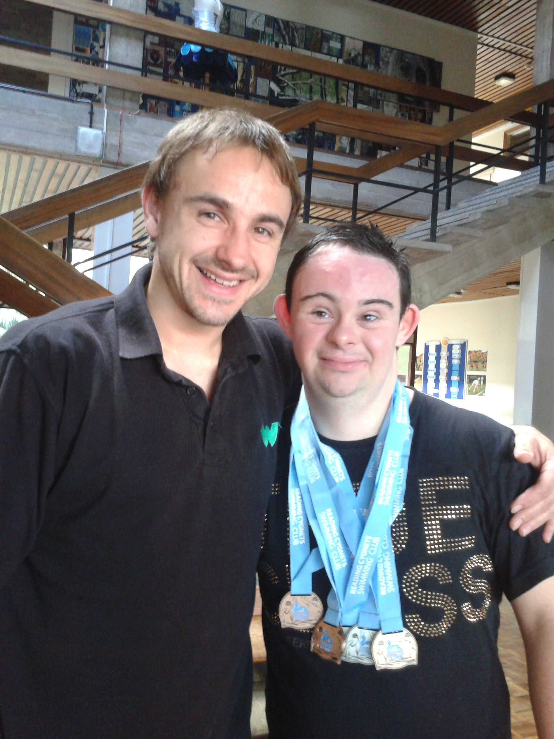 European express: Wyre Forest Swimming Club head coach Mark Wilmott with Steve Boyce and his medal haul.