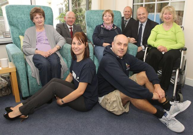 Roll up: Service users, Victoria Carpets, Community, Kemp and Nicholls Carpets and Flooring staff enjoy the new carpet. at Kemp Hospice Picture: JONATHAN HIPKISS. 421308J.