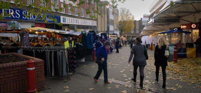 Trader concerns: Market stalls in front of shops on Kidderminster's High Street. Picture: PHIL LOACH. 481306L.