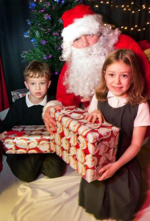 Festive fund-raising: St John's pupils Sam Amies and Lola Chetwynd-Ogden meet Santa in his grotto. (