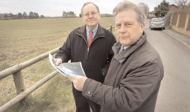 New application: Alan Smith, left and Labour councillor Jamie Shaw next to the proposed housing site after Bovis Homes first attempt. Picture: PHIL LOACH. 091302L.
