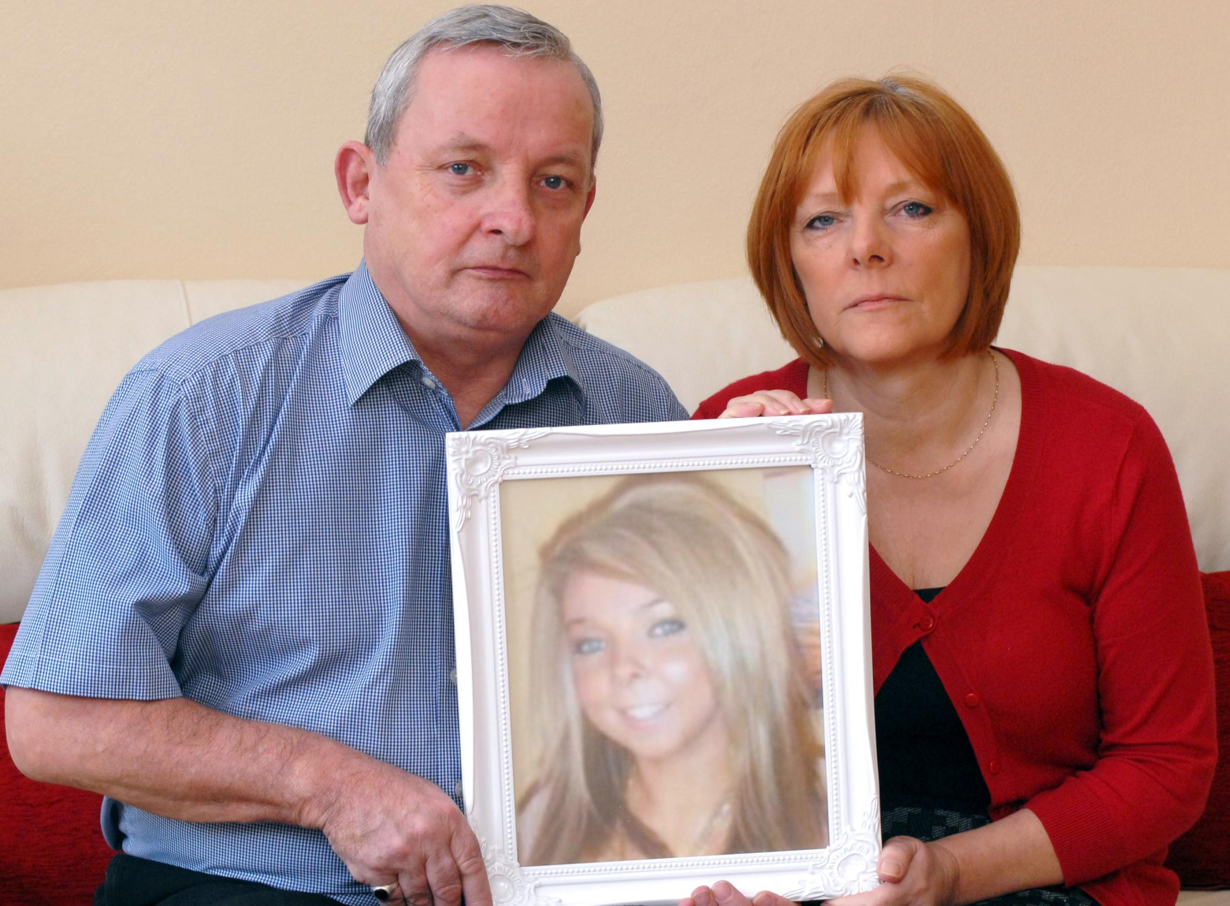Heartbroken: Eric and Lynn Harvey with a picture of their daughter Vickie.