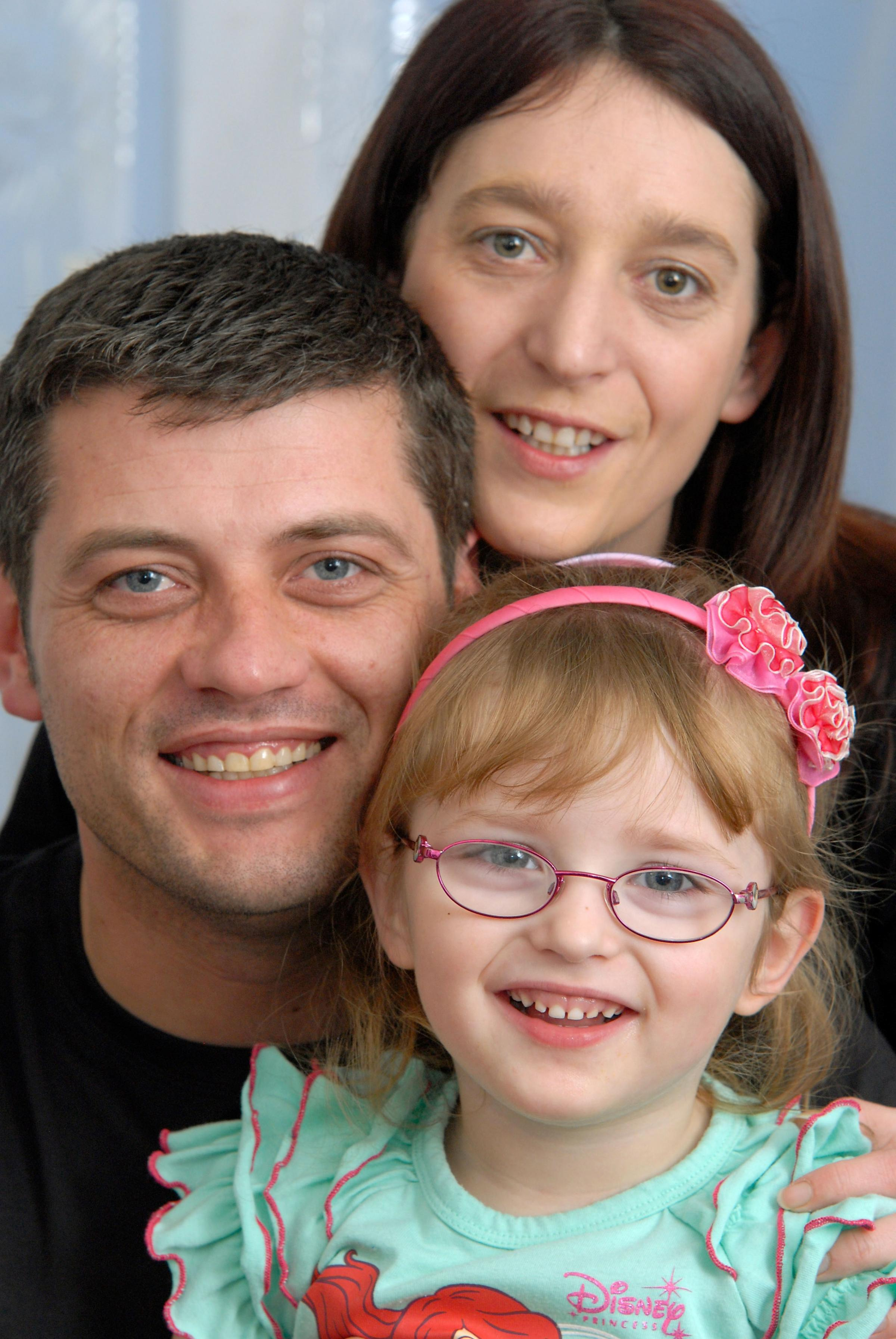 'Happy little girl': Chanelle Robertson, four, with parents Stephen and Jodie Robertson.