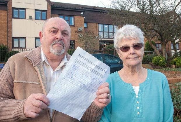 Care fears: John Farquhar, holding a copy of the petition and Jean Waldron outside Purcell House in Kidderminster. Picture: Martin Humby. 031405MH.
