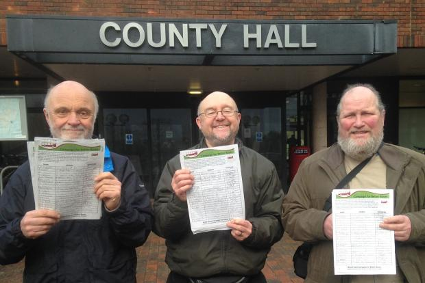 'Save Our Buses': Wyre Forest Green Party members from left, Phil Oliver, Ronald Lee and Mike Whitbread hand over the petition at County Hall.