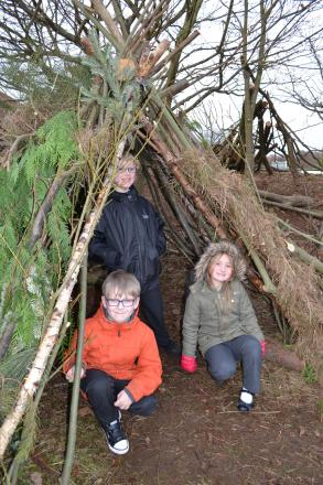 Building shelters: From left, Bailey Cale, eight, Guy Sendell, nine, and Jayme Fuszard, seven, learn to survive outdoors.