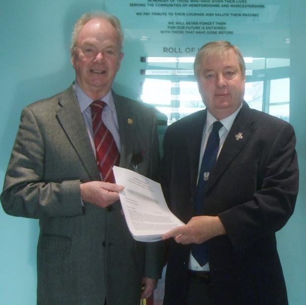 Against closure: Paul Gittins, right, handing the petition to Derek Prodger.