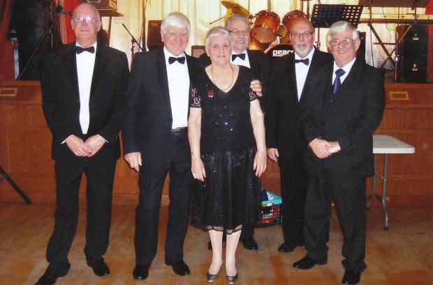 Black tie: From left, club committee members Antony Ashdown, Danny Russell, Mary Russell, Danny Taylor, Trevor Shuck and Tommy Lewis at the charity evening.