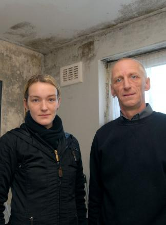 'Living in hell': Keeley and Kevin Nicholls at Keeley's flat where walls are covered in 'mould'. Picture: MIriam Balfry. 051401M.