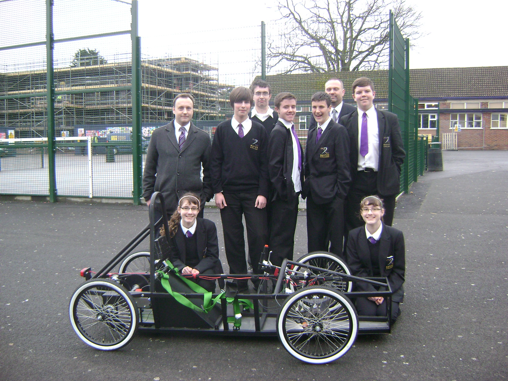 Raring to go: Teachers Michael Bullock, left, and Simon Gough, back right, with members of the Baxter College Engineering Club and their electric racing car.
