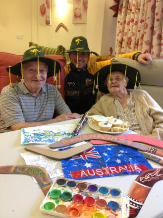 Down under: From left, resident Roy Hutton, 77, maintenance man James Drew and resident Edna Harris, 93, enjoying Australia Day.