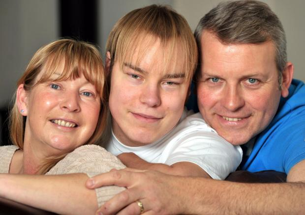 KIDNEY PLEA: Jake Woolfende n, middle, with his parents Bridget and Adrian.