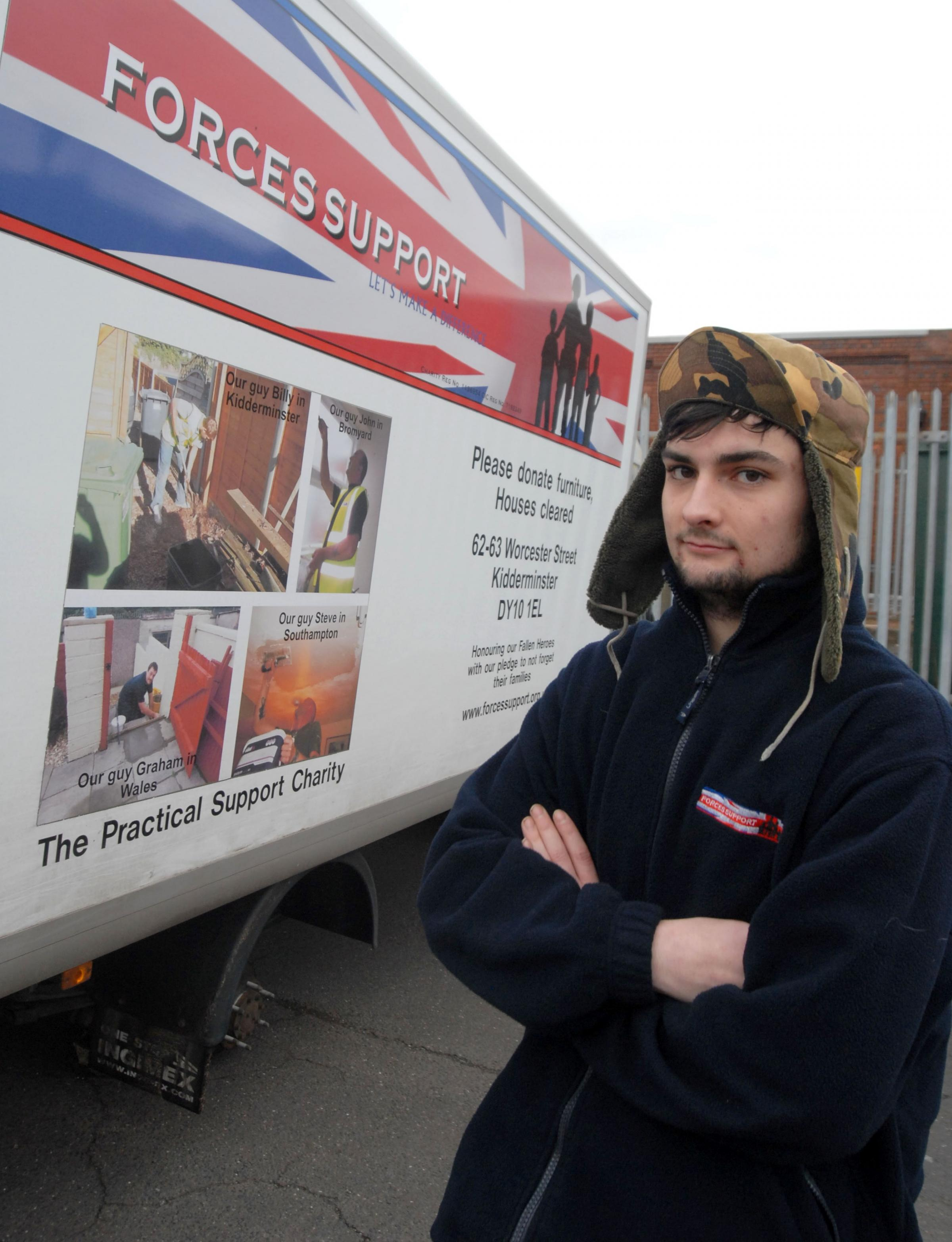 Off the road: Richard Howard, a driver's mate for the charity, with the van that had its wheels and rear lights stolen.
