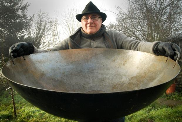 Big Pan Man: Mark Renn with one of his giant woks hired by TV celebrity chef Heston Blumenthal. Picture: Phil Loach.