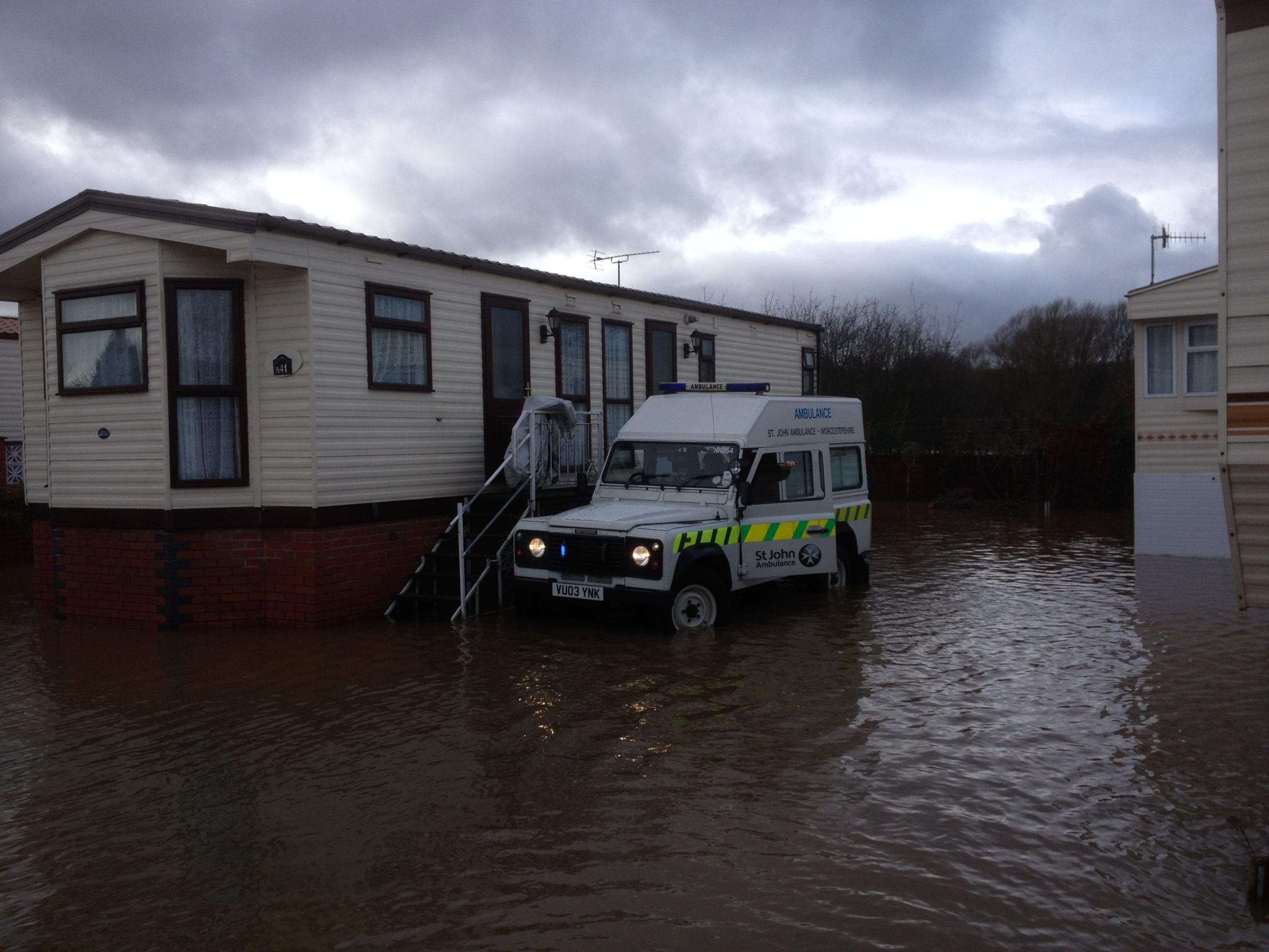 Rescue: The woman's Stourport home was surrounded by flood water.