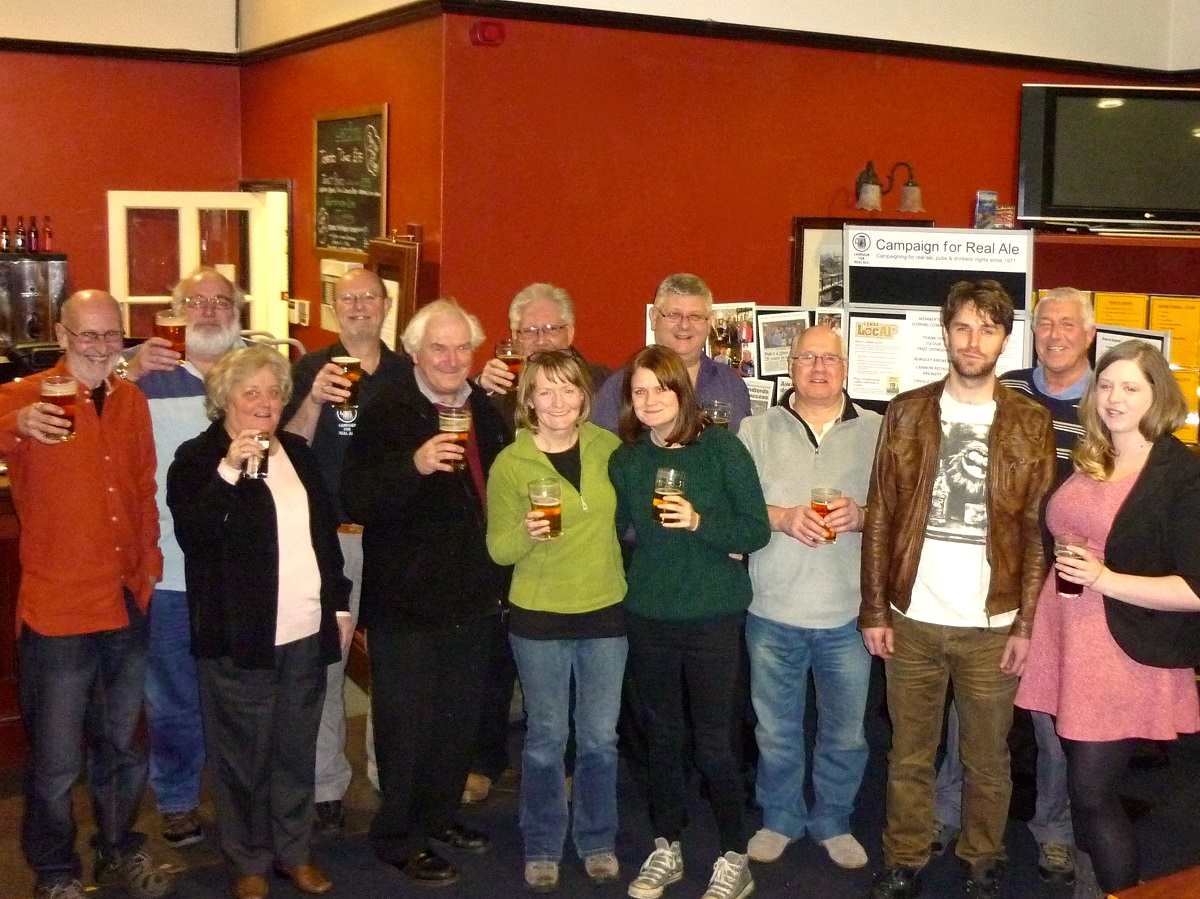 CHEERS: CAMRA members raise their glasses to celebrate the new status.