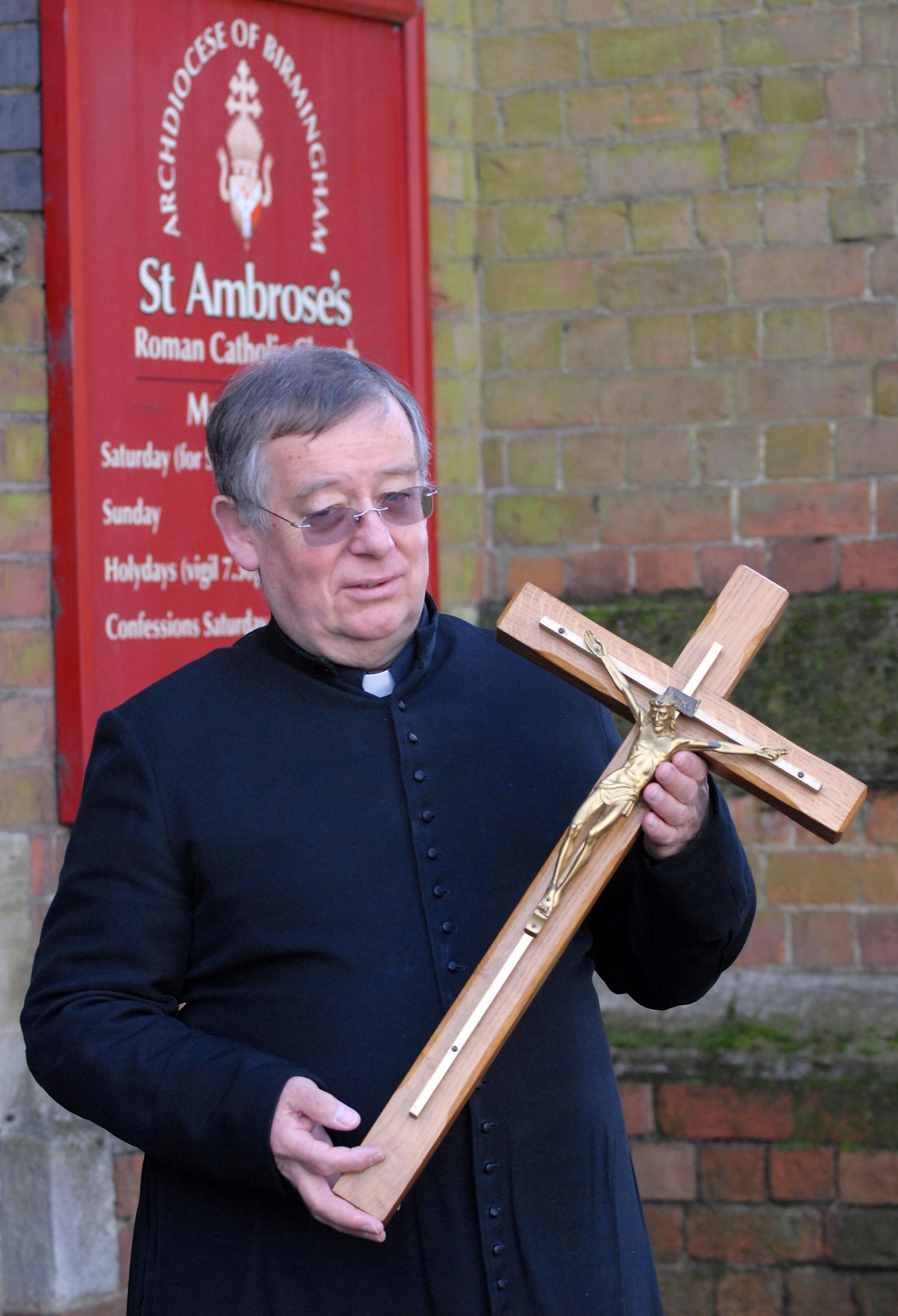 THRILLED: Father Douglas Lamb with the returned cross.