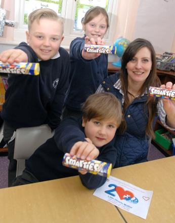 SMARTIES CHALLENGE: Samuel Robinson, front, with back from left, friends George Chance, eight and Poppy Elwell, 10 and his mother Rachel Robinson.