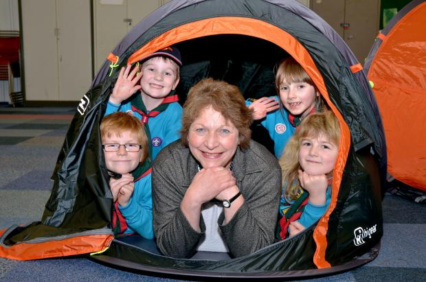 NEW TENTS: Mary Rayner, centre, with Beavers from left, James Jesson, Frankie Giles, Jemma Adkins and Louisa Godden. Photo: COLIN HILL.