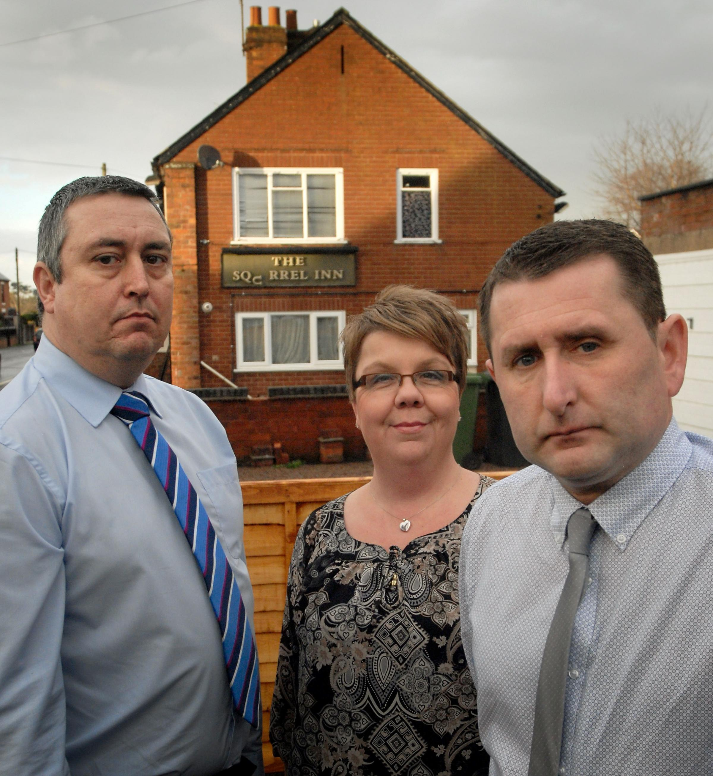 PUB THREAT: Areley Kings' Londis Pantry Stores assistant manager Richard Taylor and residents Mark and Debbie Bywater. Picture: Phil Loach. 101432L.